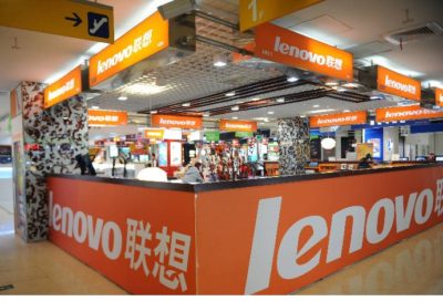 A man walks past a Lenovo shop in a computer mall in Beijing on November 3, 2011. The founder of Chinese computer giant Lenovo Group Liu Chuanzhi has stepped down as chairman, the company said as it reported a nearly 88 percent year-on-year surge in third-quarter net profit. AFP PHOTO/Peter PARKS